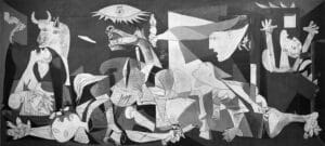 """Picasso's painting immortalized the scenes of horror when Guernica was bombed on behalf of General Franco's forces. The painting remains an emblem of resistance to the dishonesty of powerful aggressors: at the time, Franco denied responsibility for the horrors, claiming that """"the Reds"""" had """"destroyed Guernica"""" themselves in an attempt to court world sympathy."""